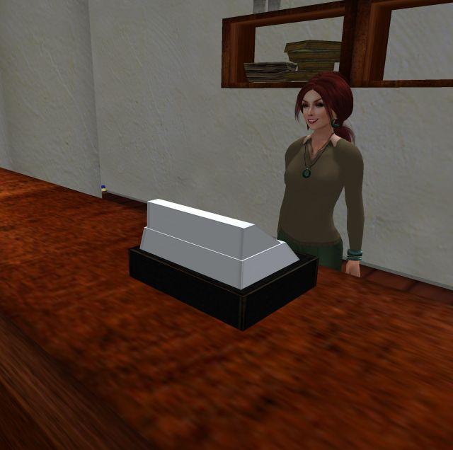 Standing behind a cash register