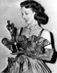 "Nobody, including Loretta Young, thought she had a snowball's chance in 1947, when she played the lead in ""The Farmer's Daughter.""  1948 rolled around, and everyone thought Rosiland Russell was a shoe-in for the little gold man.  Then Frederic March opened up the envelope as people were picking up their wraps to leave, and announced Loretta's name.  The audience gasped, then applauded wildly, while a shocked Young went up on stage in a huge taffeta gown by Adrian to accept the award she never dreamed she would get."